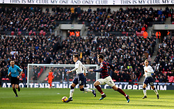Tottenham Hotspur's Harry Winks gets away from Newcastle United's Fabian Schar during the Premier League match at Wembley Stadium, London.