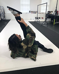 """Victoria Beckham releases a photo on Instagram with the following caption: """"Morning stretch! Kisses from London #lfw #VBSince08 Wearing my #VBPreSS18 camouflage coat"""". Photo Credit: Instagram *** No USA Distribution *** For Editorial Use Only *** Not to be Published in Books or Photo Books ***  Please note: Fees charged by the agency are for the agency's services only, and do not, nor are they intended to, convey to the user any ownership of Copyright or License in the material. The agency does not claim any ownership including but not limited to Copyright or License in the attached material. By publishing this material you expressly agree to indemnify and to hold the agency and its directors, shareholders and employees harmless from any loss, claims, damages, demands, expenses (including legal fees), or any causes of action or allegation against the agency arising out of or connected in any way with publication of the material."""