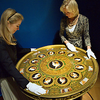 LONDON, ENGLAND - MAY 22:  Members of staff from the Royal Collection with The Table of Grand Command  that was commisioned by Napoleon in 1806. The Exhibition will open on May 23rd at Buckingham Palace Galleries. On May 22, 2009 in London, England.  (Photo by Marco Secchi/Getty Images)