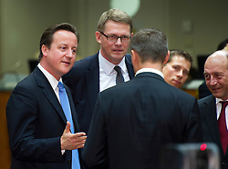 David Cameron, the U.K.'s prime minister, left, speaks with Matti Vanhanen, Finland's prime minister center, Andrus Ansip, Estonia's prime minister, back to camera, and Traian Basescu, Romania's president, right, during the European Summit meeting at EU Council headquarters in Brussels, Belgium, on Thursday, June 17, 2010. (Photo © Jock Fistick)