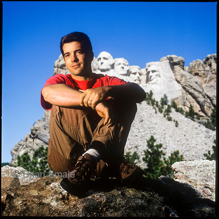 John F Kennedy Jr. at Mt Rushmore.  Photographed by Brian Smale.