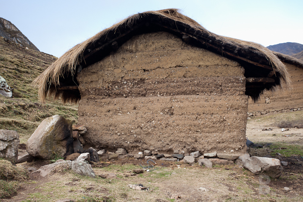 A tatched roof adobe  home in a tiny community in the Cordillera Huayhuash in the Andes Mountains of Peru near Lake Carhuacocha.