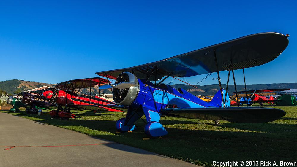 Front row near to far 1932 Waco UBF, 1928 Waco ATO, 1935 Waco YPF, and 1932 Waco UBA at the 2013 Hood River Fly In at WAAAM.