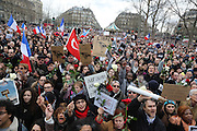 """A massive public rally """"Cry for Freedom"""" takes place in central Paris on Sunday afternoon. The rally brought in people of all colors and creeds from both France and abroad. Many were carrying placards with various slogans. This demonstration happened the weekend after armed gunmen attacked the offices of Charlie Hebdo, killing twelve people, including the editor and celebrated cartoonists; four more are in critical condition. It is the dealiest terror attack in France for over fifty years. Charlie Hebdo is a satirical publication well known for its political cartoons. The jihadists responsible were killed by police in several shootouts on the Friday afternoon. <br /><br />As a solidarity actions with the deaths at Charlie Hebdo many placards read """"Je suis Charlie"""" translating as """"I am Charlie (Hebdo)"""". Demonstrators held aloft pens, brushes and crayons, symbolizing the profession of journalists and cartoonists who were killed. Many pens were placed in a shrine with candles in the square. Some protesters also refused to ally themselves with Charlie Hebdo."""