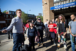© Licensed to London News Pictures. 03/05/2018. London, UK. Journalist and Labour activist OWEN JONES (left) speaks outside Pimlico Tube Station as part of 'Unseat Westminster Tory Council'. The gathering was arranged to round up volunteers to speak to Westminster residents who said they would vote for labour. Photo credit : Tom Nicholson/LNP