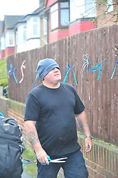 © Licensed to London News Pictures.10/04/2018<br /> HITHER GREEN, UK.<br /> FLOWERS GETTING CUT DOWN BY LOCAL MAN AFTER BEING UP FOR HALF AN HOUR<br />  Hither Green Burglary Murder. South Park Crescent,Hither Green.<br /> Family and friends of Henry Vincent arrive to hang up the ripped down flowers  outside the home of 78 year old Richard Osborn-Brooks who stabbed a burglar to death in his home.<br /> Photo credit: Grant Falvey/LNP