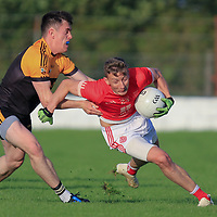 Eire Og's Mark Roche is tackled by Coolmeen's Gary Meaney