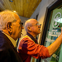 040715       Cable Hoover<br /> <br /> Jay Dee Pfannenstiel, right, and mayoral candidate George Galanis look at the results of the early and absentee voting posted on the doors of City Hall Tuesday in Gallup.
