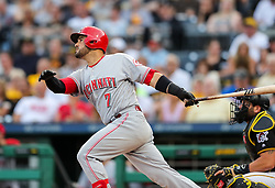 Jun 15, 2018; Pittsburgh, PA, USA; Cincinnati Reds third baseman Eugenio Suarez (7) hits for a single during the second inning against the Pittsburgh Pirates at PNC Park. Mandatory Credit: Ben Queen-USA TODAY Sports
