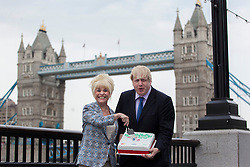 © licensed to London News Pictures. London, UK 07/05/2013. Mayor of London Boris Johnson and EastEnders star Barbara Windsor posing with a cake and tea pot outside City Hall to promote the Big Lunch. Photo credit: Tolga Akmen/LNP
