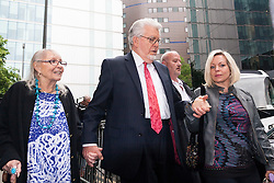 London May 28th 2014. Entertainer and TV presenter Rolf Harris leaves court withis wife Alwen, left and daughter Bindi after cross examination by the prosecution in his trial on 12 counts of indecent assault against four girls aged 7 to 19, alleged to have taken place between the mid 60s and 90s.