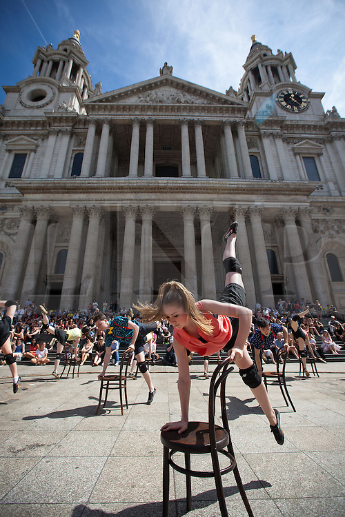 © Licensed to London News Pictures. 15/07/2013. London, UK. Students from the Central School of Ballet dance for tourists and office workers on a lunch break outside St Paul's Cathedral in London today (15/07/2013). The dance piece, which was specially commissioned by the City of London, forms part of the City of London Festival which runs until the 26th of July. Photo credit: Matt Cetti-Roberts/LNP