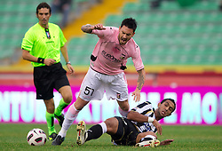 Pinilla Mauricio Ricardo Ferrera of Palermo vs Benatia Al Mouttaqui Medhi of Udinese during football match between Udinese Calcio and Palermo in 8th Round of Italian Seria A league, on October 24, 2010 at Stadium Friuli, Udine, Italy.  Udinese defeated Palermo 2 - 1. (Photo By Vid Ponikvar / Sportida.com)