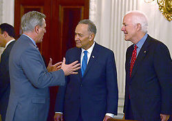 United States House Majority Leader Kevin McCarthy (Republican of California), left, engages in conversation with US Senate Minority Leader Chuck Schumer (Democrat of New York), center, as US Senate Majority Whip John Cornyn (Republican of Texas), right, looks on prior to the arrival of President Donald Trump at a reception for US House and US Senate Republican and Democratic leaders in the State Dining Room of the White House in Washington, DC, USA, on Monday, January 23, 2017. Photo by Ron Sachs/CNP/ABACAPRESS.COM