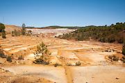 Lunar like despoiled landscape opencast mineral extraction in the Minas de Riotinto mining area, Huelva province, Spain