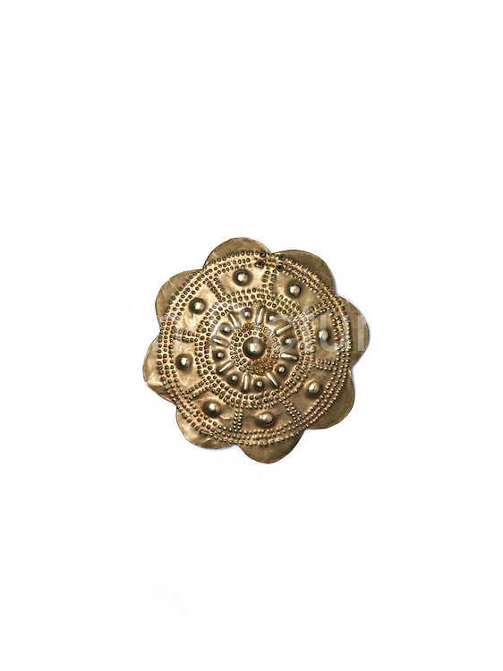 An Akha Puxo shirt 'button' made from aluminium, Ban Bounphieng, Phongsaly province, Lao PDR.  In the traditional Akha view art is something one wears and makes a statement which is ethnic, personal and aesthetic.