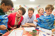 © Licensed to London News Pictures. 01/05/2014. Surbiton, UK. (L-R adults) London MEP Sarah Ludford, Nick Clegg, Lingston Council Leader Liz Green. Deputy Prime Minister Nick Clegg visits Lime Tree Primary School in Surbiton today 1st May 2014. Whilst there he took part in a painting, phonics and maths projects with school children. Photo credit : Stephen Simpson/LNP