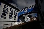 Diamantina_MG, Brasil...Casa da Gloria - Integrada por duas edificacoes dos séculos XVIII e XIX ligadas por um passadiço, ja abrigou o colégio das irmas vicentinas e hoje e sede do Centro de Geologia Eschwege, da UFMG. ..Casa da Gloria is actually a linked house made up of two houses connected by a blue passageway. Built in 1876, this passageway, Passadico da Gloria, best represents Diamantina on post cards. ..Foto: LEO DRUMOND / NITRO