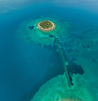 Aerial view of small islet of Itea called Agios Athanasios in Greece
