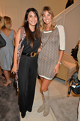 Left to right, LOHRALEE ASTOR and MALIN JEFFERIES at a lunch hosted by Alice Naylor-Leyland and Tamara Beckwith in celebration of the Coach 2015 collection held at Coach, New Bond Street, London on 18th September 2014.