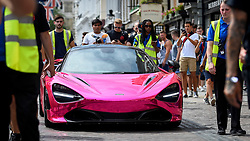 © Licensed to London News Pictures. 04/08/2018. LONDON, UK. A McLaren 720s arrives in Covent Garden for Gumball 3000, a charity race for supercars and more.  150 cars will journey from London to Tokyo in a race which commences on Sunday 5 August.  Photo credit: Stephen Chung/LNP