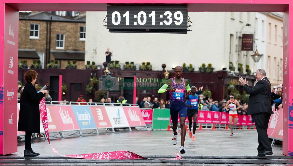 Mo Farah crosses the line to win the Vitality Big Half in London City Centre.