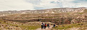 Group of hikers in the Kidron Valley, Judean Desert, Israel / Palestine