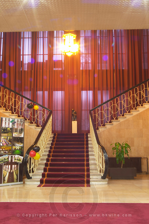 The lobby and reception at the Hotel Crna Gora built and decorated in old fashioned eastern European style. Imposing staircase leading down to the lobby. Podgorica capital. Montenegro, Balkan, Europe.