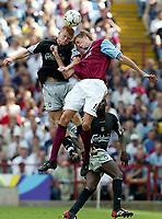 Fotball. Premier League. 18.08.2002.<br /> Aston Villa v Liverpool<br /> John Arne Riise, Liverpool.<br /> Steve Staunton, Villa.<br /> Foto: David Rawcliffe, Digitalsport