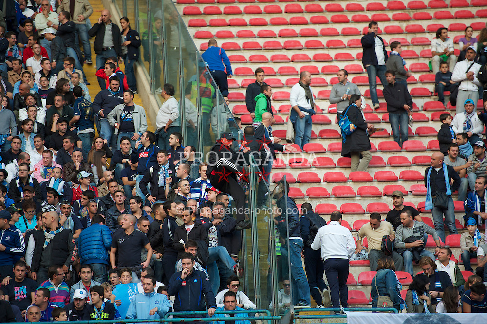 NAPELS, ITALY - Thursday, October 21, 2010: SSC Napoli supporters climb over a dividing section during the UEFA Europa League Group K match against Liverpool at the Stadio San Paolo. (Pic by: David Rawcliffe/Propaganda)