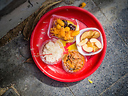 22 AUGUST 2015 - BANGKOK, THAILAND: Food left as an offering for the spirits of people killed in the terrorist bombing at the Erawan Shrine in Bangkok. Erawan Shrine in Bangkok reopened Wednesday, August 19, after more than 20 people were killed and more than 100 injured in a bombing at the shrine Monday, August 17, 2015. The shrine is a popular tourist attraction in the center of Bangkok's high end shopping district and is an important religious site for Thais. No one has claimed responsibility for the bombing.             PHOTO BY JACK KURTZ