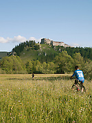 Cyclists at the Chateau le Joux, in La Cluse-et-Mijoux in the Jura region of France