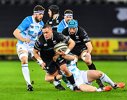 Ospreys' Hanno Dirksen is tackled by Leinster's Rory O'Loughlin<br /> <br /> Photographer Craig Thomas/Replay Images<br /> <br /> Guinness PRO14 Round 18 - Ospreys v Leinster - Saturday 24th March 2018 - Liberty Stadium - Swansea<br /> <br /> World Copyright © Replay Images . All rights reserved. info@replayimages.co.uk - http://replayimages.co.uk