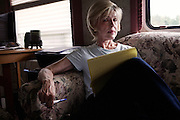 """Judy Rivers of Cullman, Alabama, sits in the RV that has been her temporary home for the past two years. When the credit system declared her dead in 2010, Rivers struggled to get a job because she failed background checks and no longer had a credit history. In May 2012, she was finally """"resurrected"""" and once again able to open a checking account. In her spare time, Rivers researches the surprisingly regular phenomenon of credit deaths in America, with the hope of helping others who share her predicament."""