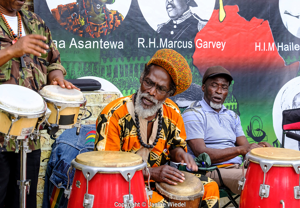 Rastafarians playing drums at Groundation drumming music at annual Reparation Rebellion event on Afrikan Emancipation Day in Windrush Square Brixton 2021.