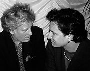 Photo of Chris Blackwell and Bono of U2  at the Achtung Baby party - London 1991