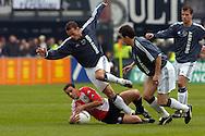 Photo: Gerrit de Heus. Rotterdam. 11/04/04..Feyenoord-Ajax. Wesley Sneijder struikelt over Anthony Lurling.
