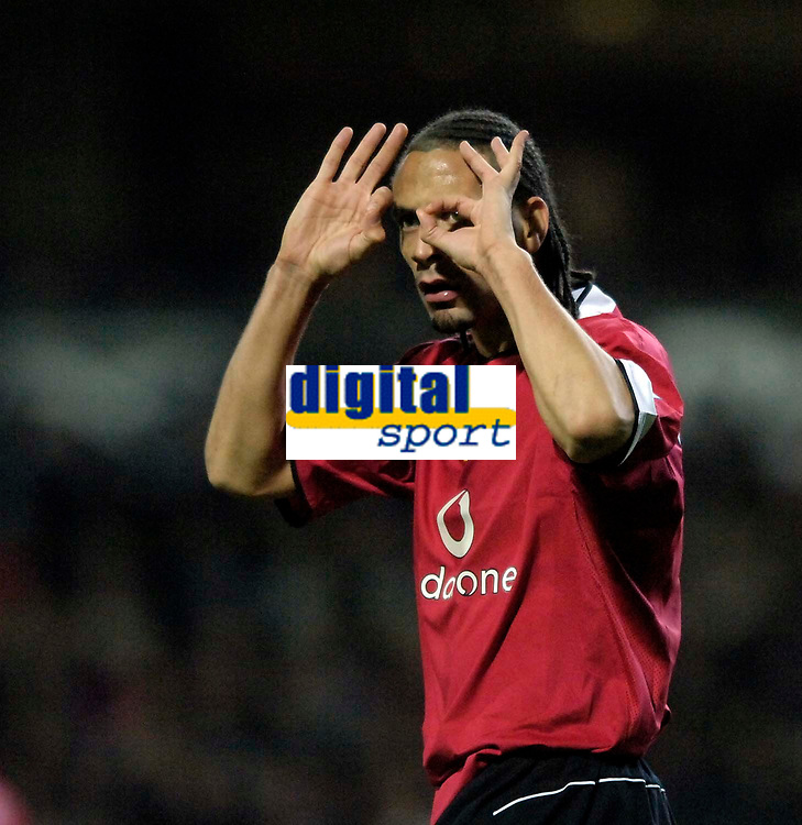 Photo: Jed Wee.<br /> Blackburn Rovers v Manchester United. Carling Cup. Semi Final, 1st Leg. 11/01/2006.<br /> <br /> Manchester United's Rio Ferdinand signals to the referee's assistant that he should get a pair of spectacles.