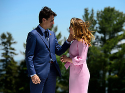 Prime Minister Justin Trudeau and wife Sophie Gregoire Trudeau wait to greet the leaders at the official welcoming ceremony at the G7 Leaders Summit in La Malbaie, Quebec, Canada on Friday, June 8, 2018. Photo by Sean Kilpatrick/CP/ABACAPRESS.COM