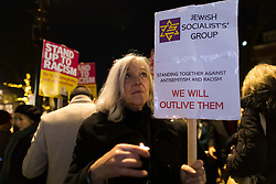 © Licensed to London News Pictures. 30/12/2019. London, UK. People take part in a protest vigil against anti-semitic graffiti in Hampstead and Belsize Park, held in Rosslyn Hill in Hampstead. Yesterday, anti-semitic graffiti was daubed on a synagogue and several shops in north London during the Jewish festival of Hanukkah. Photo credit: Vickie Flores/LNP