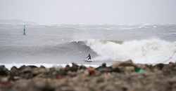 © Licensed to London News Pictures. 23/03/2013..Cleveland, England..Surfer Gabe Davies from Tynemouth surfs the waves as the wintery weather continues to chill the country. Cleveland on the east coast of England suffered freezing cold temperatures and strong winds that brought big seas to the coastline...Photo credit : Ian Forsyth/LNP