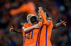 07-10-2016 NED: WK kwalificatie Nederland - Wit-Rusland, Rotterdam<br /> Het Nederlands elftal heeft in De Kuip een 4-1 overwinning op Wit-Rusland geboekt / Quincy Promes scoort de 2-0 en viert dit met Virgil van Dijk en Davy Klaassen.