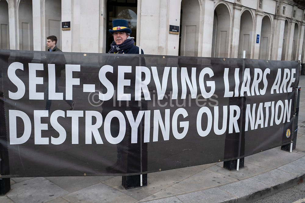 Self serving liars are destroying our nation, anti Tory banner in Westminster on 14th April 2021 in London, United Kingdom. The banners have been put up outside Parliament by the anti-Brexit protesters and is against Conservative Party policy, and specifically now due to the Greensill lobbying scandal.