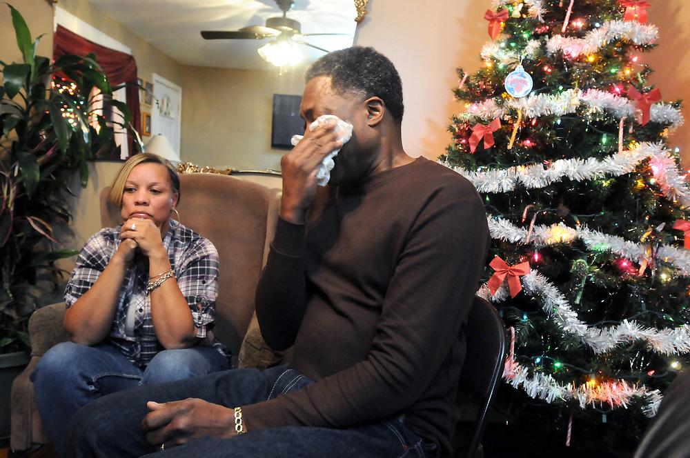 (Mara Lavitt — New Haven Register) <br /> December 12, 2013 West Haven<br /> Celeste and Gregory Fulcher, parents of Key Club shooting victim Erika Robinson, at home in West Haven.