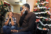 (Mara Lavitt — New Haven Register) <br /> December 12, 2013 West Haven<br /> Celeste and Gregory Fulcher, parents of Key Club shooting victim Erika Robinson, at home in West Haven.