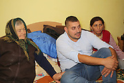 Razvan in his bedroom surrounded by his grand-mother and his mum (on the right).
