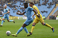 Coventry City forward (on loan from Wolverhampton Wanderers)Bright Enobakhare (24) crosses during the EFL Sky Bet League 1 match between Coventry City and Bristol Rovers at the Ricoh Arena, Coventry, England on 7 April 2019.
