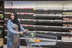 © Licensed to London News Pictures.  22/07/2021. London, UK. Empty shelves in Asda, Stamford Hill, north London.  Supermarkets have warned they could start running out of food in 48 hours. Many stores had to close due to a lack of workers having to self-isolate.  Photo credit: Marcin Nowak/LNP