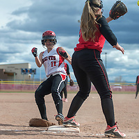 Grants Pirate Amber Ramirez (12) rushes to steal third before Albuquerque Charger Alix Hamon (20) catches the ball Tuesday in Grants.