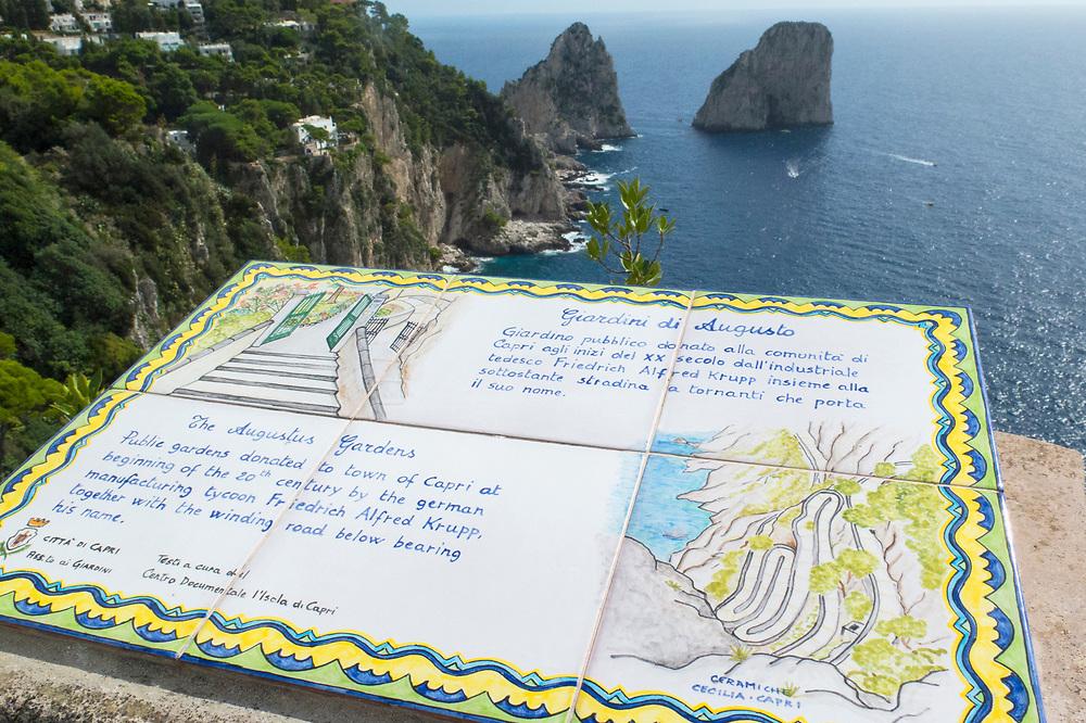 View of Il Faraglioni rock outcroppings off the coast of Capri Island, Italy with Augustus Garden descriptive art ceramic
